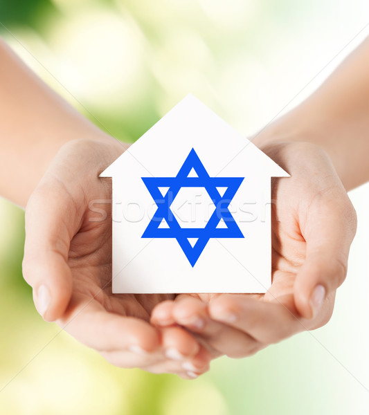 Mains maison star religion Photo stock © dolgachov