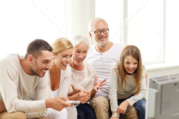 Stok fotoğraf: Mutlu · aile · izlerken · tv · ev · aile · mutluluk