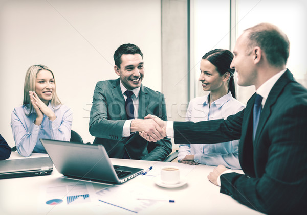 two businessman shaking hands in office Stock photo © dolgachov