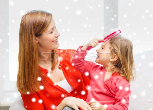 Moeder dochter kam familie jeugd vakantie Stockfoto © dolgachov