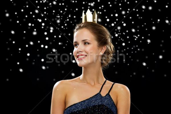 Mosolygó nő estélyi ruha visel korona emberek ünnepek Stock fotó © dolgachov
