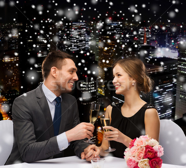 smiling couple at restaurant Stock photo © dolgachov