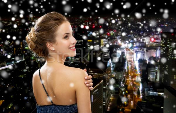 Mujer sonriente vestido de noche personas vacaciones glamour negro Foto stock © dolgachov