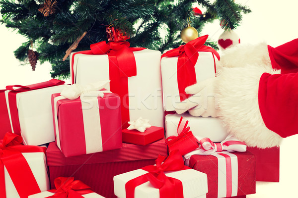 close up of santa claus with presents Stock photo © dolgachov