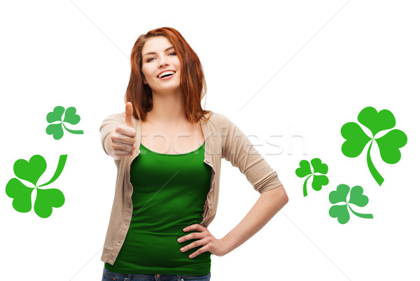 smiling teen girl with shamrock showing thumbs up Stock photo © dolgachov