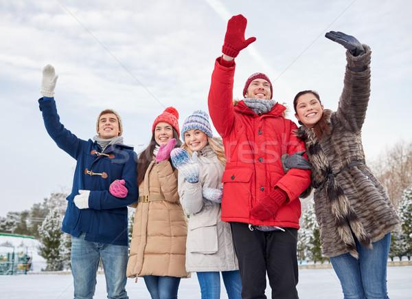 Boldog barátok integet kezek jég pálya Stock fotó © dolgachov