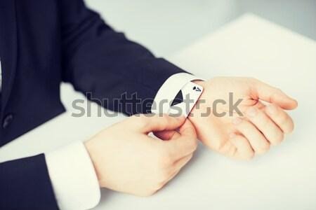 Strony ukrywanie as rękaw działalności Zdjęcia stock © dolgachov