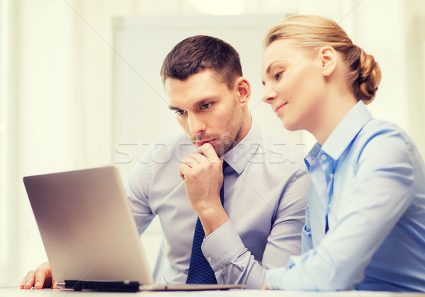 serious business couple with laptop computer Stock photo © dolgachov