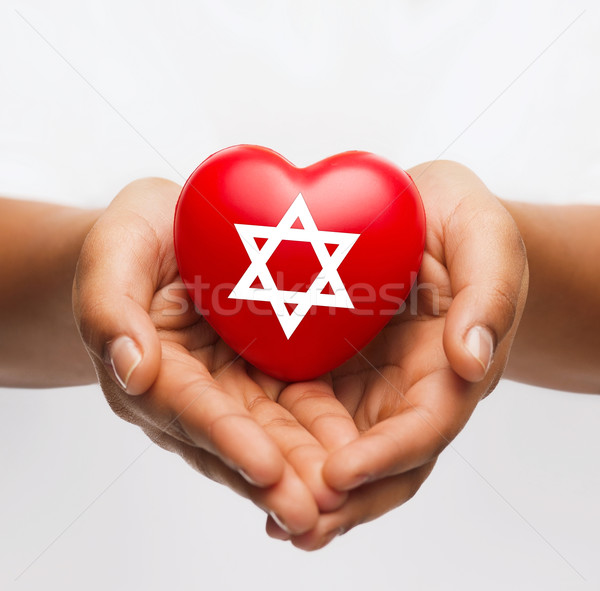 Feminino mãos coração estrela religião Foto stock © dolgachov