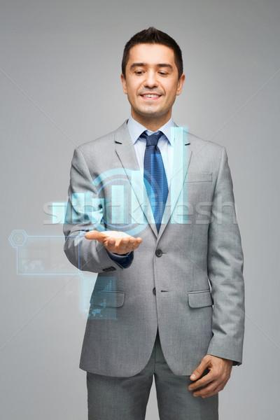 Boldog üzletember mutat virtuális diagram vetítés Stock fotó © dolgachov