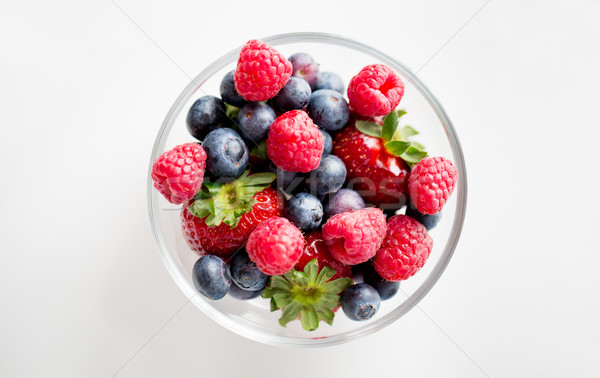 close up of summer berries in glass bowl Stock photo © dolgachov