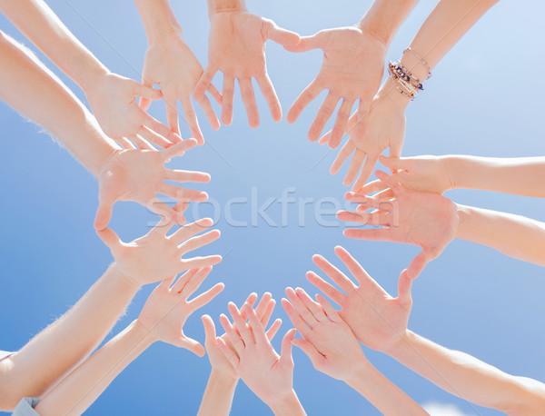 çok eller mavi gökyüzü beraberlik takım sendika Stok fotoğraf © dolgachov