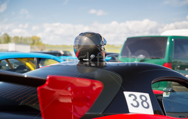close up of car with helmet on roof top Stock photo © dolgachov