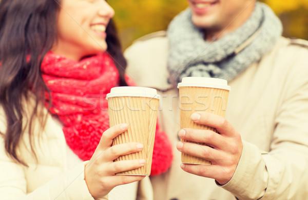 Sorridente casal xícaras de café outono parque amor Foto stock © dolgachov
