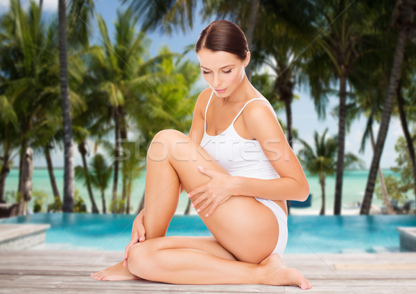 beautiful woman touching her hips over beach Stock photo © dolgachov