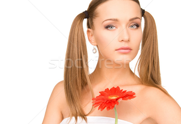 woman in towel with red flower Stock photo © dolgachov