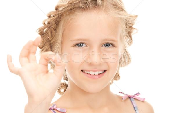 Luminoso foto ragazza segno Foto d'archivio © dolgachov