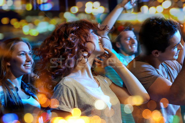 счастливым друзей танцы ночной клуб вечеринка праздников Сток-фото © dolgachov