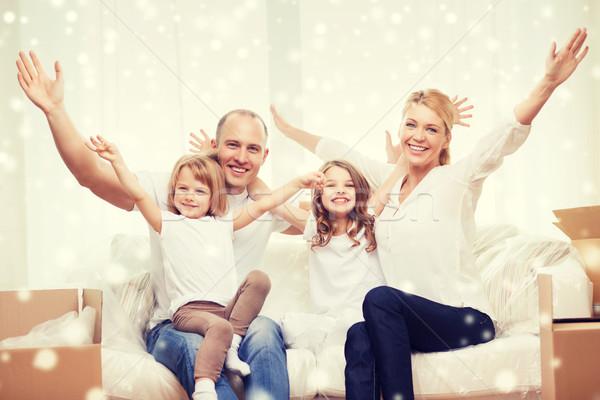 Glimlachend ouders twee nieuw huis familie Stockfoto © dolgachov