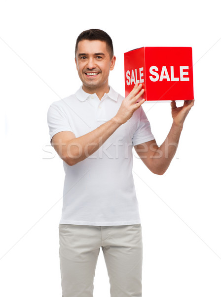 smiling man with red sale sigh Stock photo © dolgachov