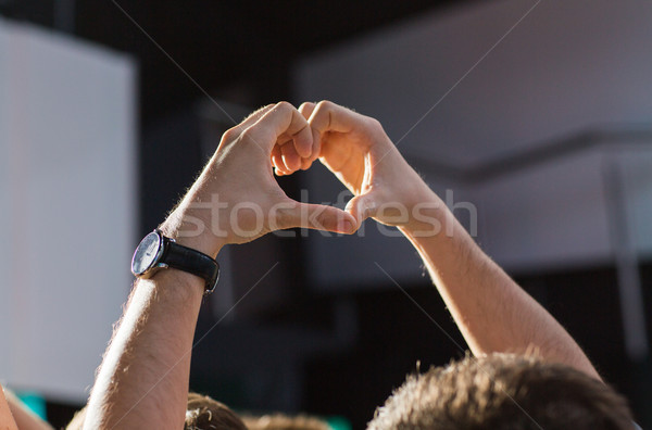 close up of fan hands showing heart at concert Stock photo © dolgachov