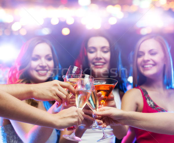 happy friends clinking glasses at night club Stock photo © dolgachov