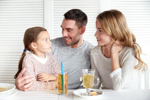 Boldog család vacsora étterem kávézó család nevelés Stock fotó © dolgachov