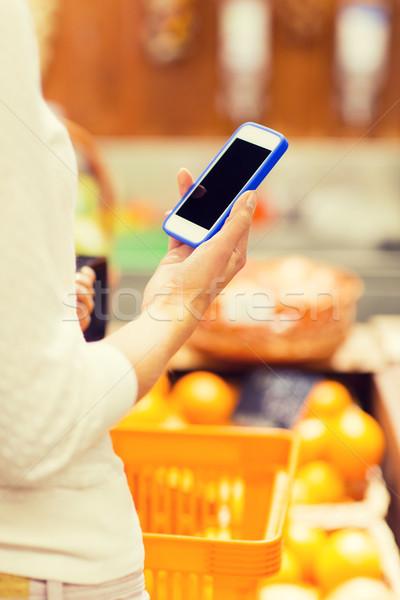 Stockfoto: Vrouw · voedsel · mand · markt · verkoop