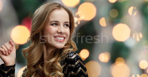 happy young woman dancing at night club disco Stock photo © dolgachov