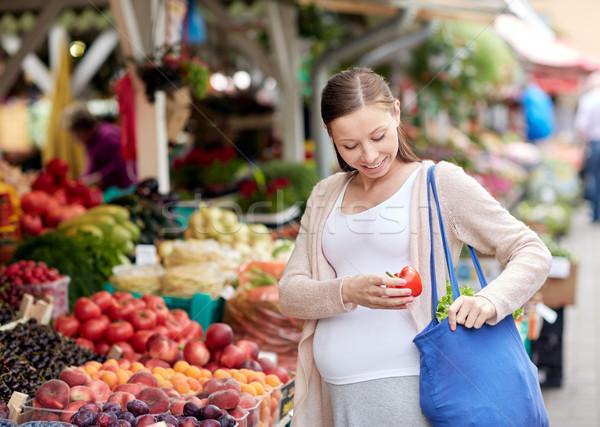 pregnant woman buying food at street market Stock photo © dolgachov