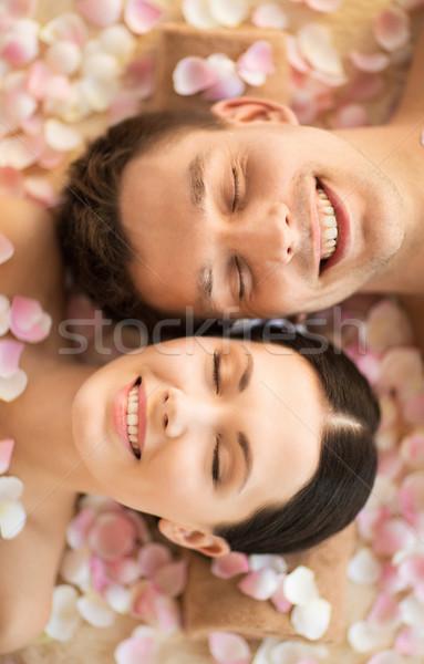 Casal estância termal faces salão massagem flores Foto stock © dolgachov