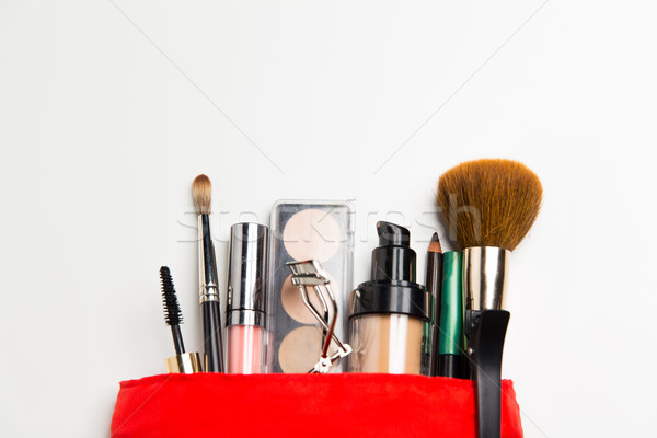 close up of cosmetic bag with makeup stuff Stock photo © dolgachov