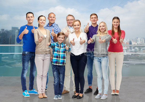 group of smiling people showing thumbs up Stock photo © dolgachov