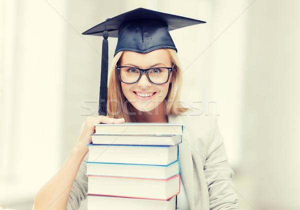 student in graduation cap Stock photo © dolgachov