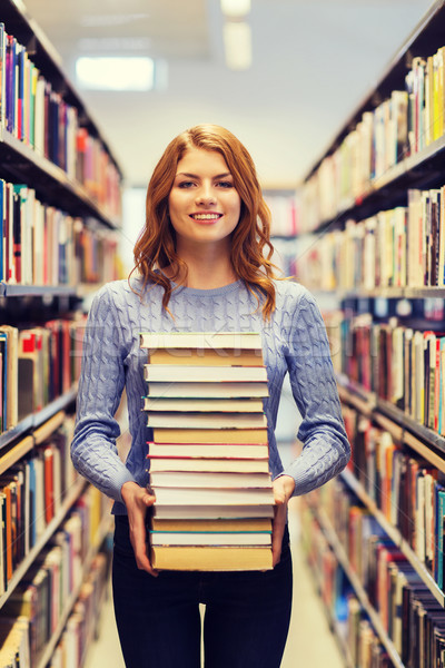 Feliz estudiante nina mujer libros biblioteca Foto stock © dolgachov