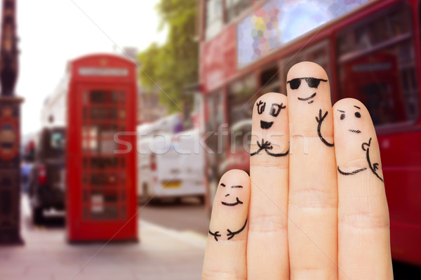 close up of four fingers with smiley faces Stock photo © dolgachov