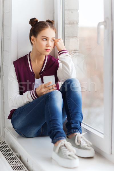 Genç kız oturma pencere eşiği insanlar duygu Stok fotoğraf © dolgachov
