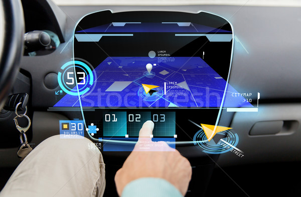 close up of man with gps navigator on car computer Stock photo © dolgachov