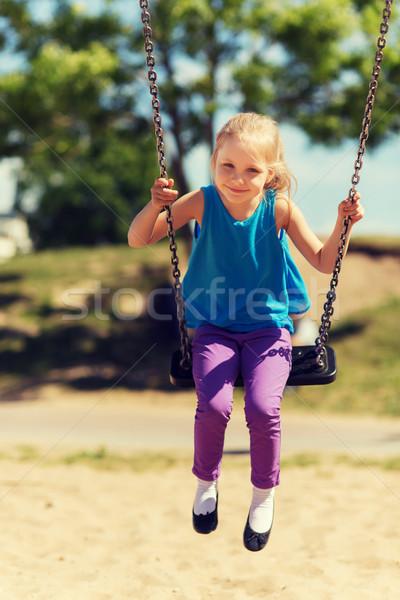 Boldog kislány hinta játszótér nyár gyermekkor Stock fotó © dolgachov