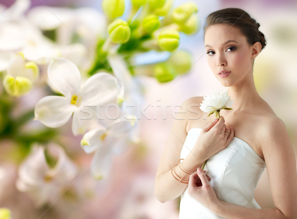 beautiful asian woman with flower and jewelry Stock photo © dolgachov