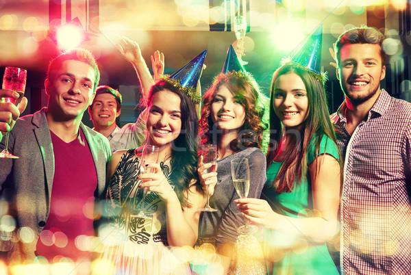 улыбаясь друзей очки шампанского клуба вечеринка Сток-фото © dolgachov