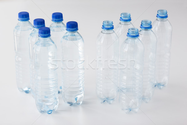 close up of bottles with drinking water on table Stock photo © dolgachov