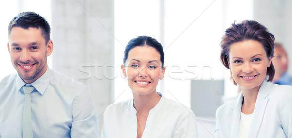 üzleti csapat megbeszél valami iroda mosolyog üzlet Stock fotó © dolgachov