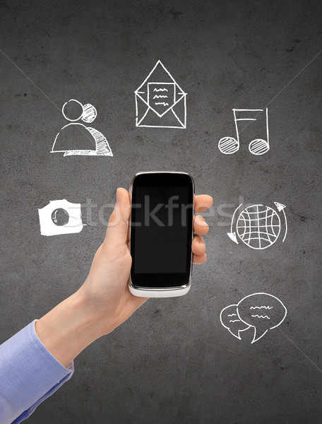 close up of hand with smartphone and media doodles Stock photo © dolgachov
