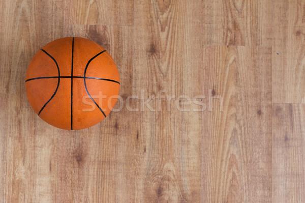 close up of basketball ball on wooden floor Stock photo © dolgachov