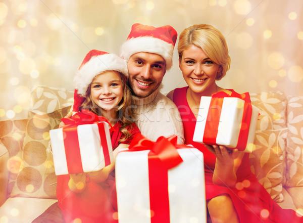 smiling family giving many gift boxes Stock photo © dolgachov