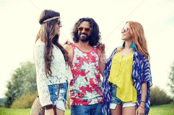 smiling young hippie friends talking outdoors Stock photo © dolgachov