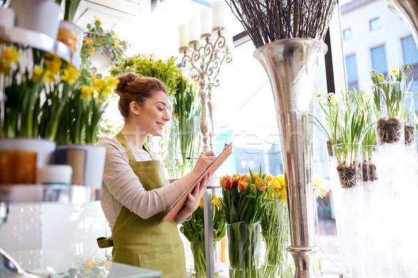Florista mujer portapapeles personas venta Foto stock © dolgachov