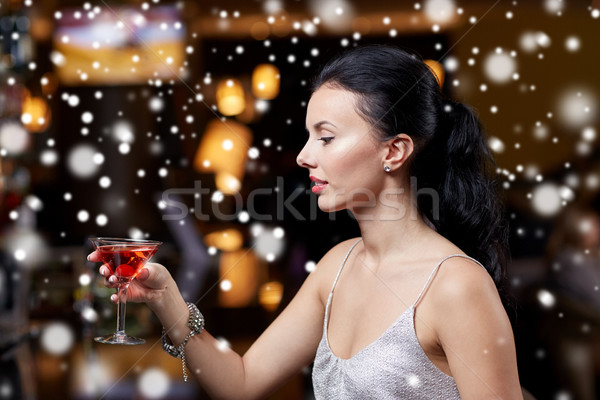 glamorous woman with cocktail at night club or bar Stock photo © dolgachov