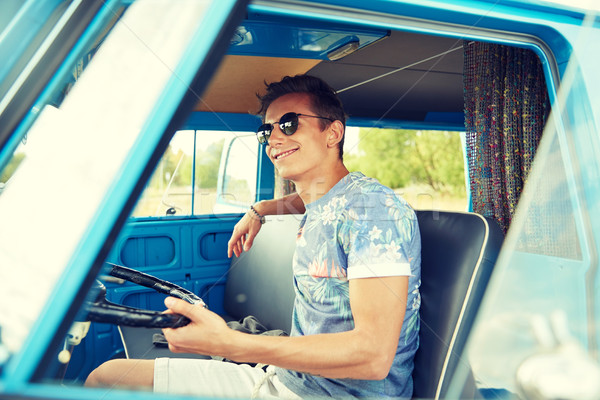 smiling young hippie man driving minivan car Stock photo © dolgachov